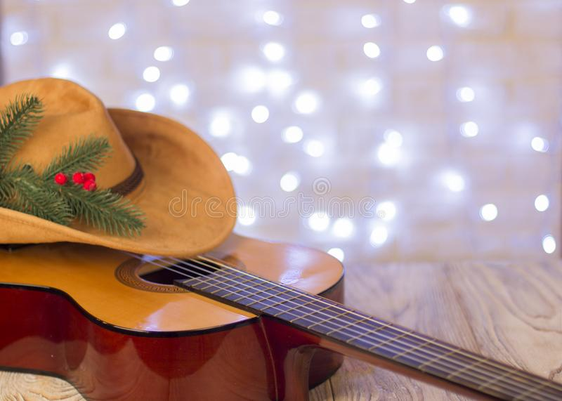 Christmas background.Country music with acoustic guitar and amer. Ican cowboy hat stock photo