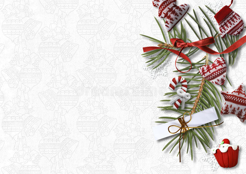 Christmas background with cozy sweet decorations on white backdrop, postcard stock photo