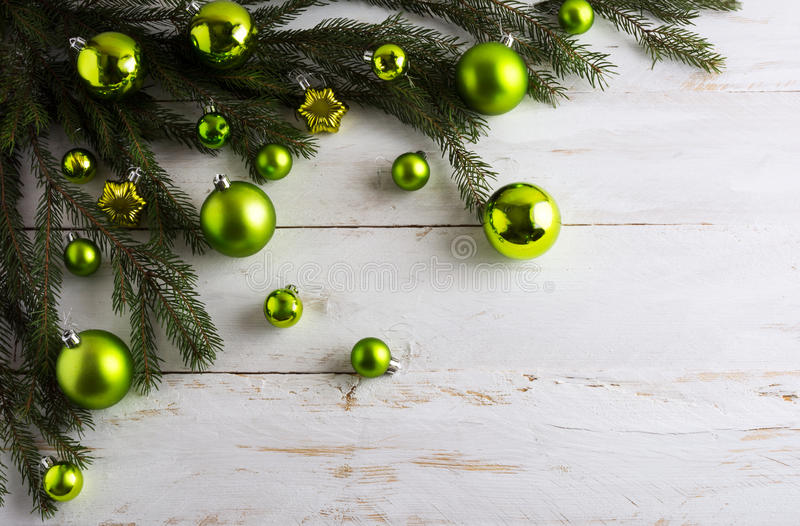 Christmas background decorated with green bauble hanging stock photos