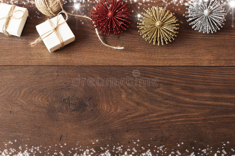 Christmas background with decorations and gift boxes on wooden board. Blue sparkly holiday background with copy space stock photo