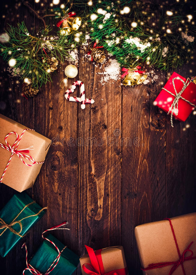 Christmas background. With decorations and gift boxes on wooden board. vintage styles royalty free stock photography