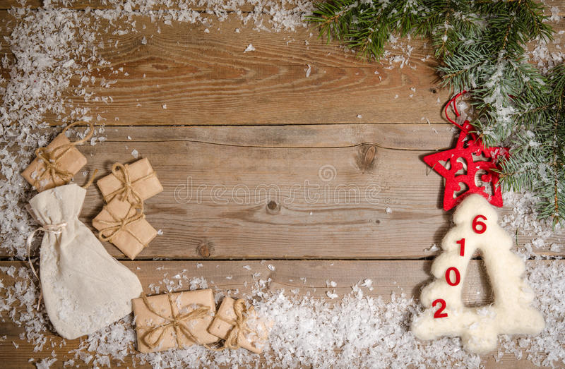 Christmas background with decorations, parcels, fir and snow on royalty free stock image
