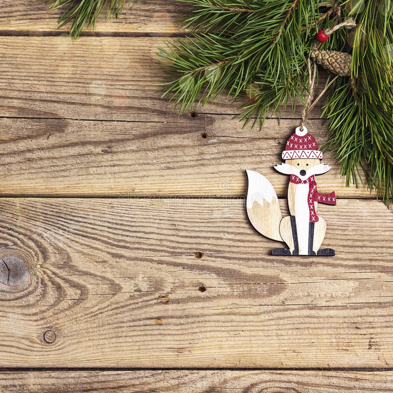 Christmas background with decorative fox and pine branches on old wooden boards with space for text. Top view stock photos