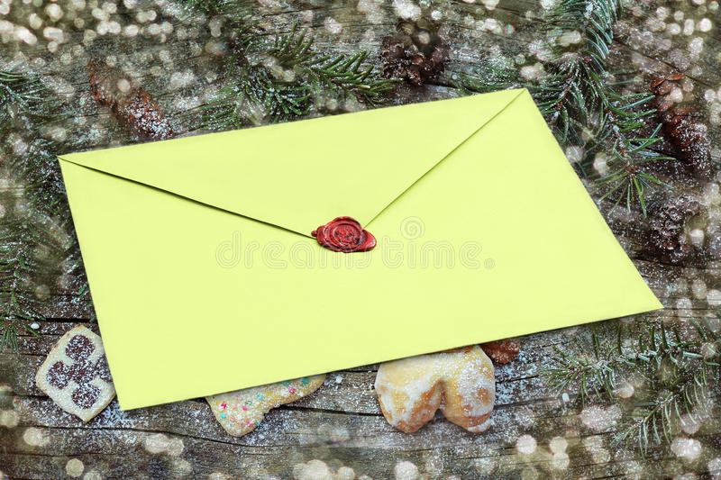 Christmas background with envelope on a wooden background with cookies and pine branches royalty free stock photos