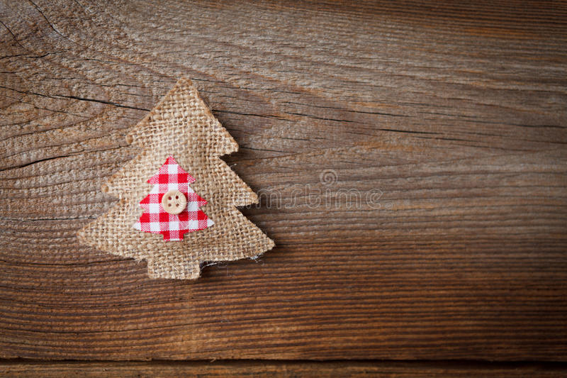 Christmas background with fabric christmas tree. Christmas decoration on weathered wooden board royalty free stock image