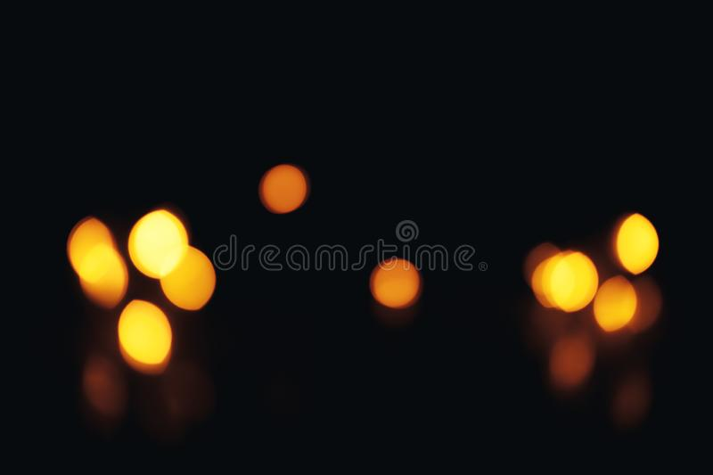 Defocused gold abstract christmas background. Bokeh. a little bit in corner. Christmas background. Festive abstract background with bokeh defocused lights and royalty free stock photos