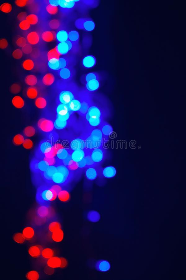 Christmas background. Festive elegant background with bokeh lights and stars. Vintage filter effect with copy space stock photo
