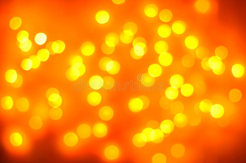 Christmas background. Festive gold abstract background with bokeh defocused lights stock images