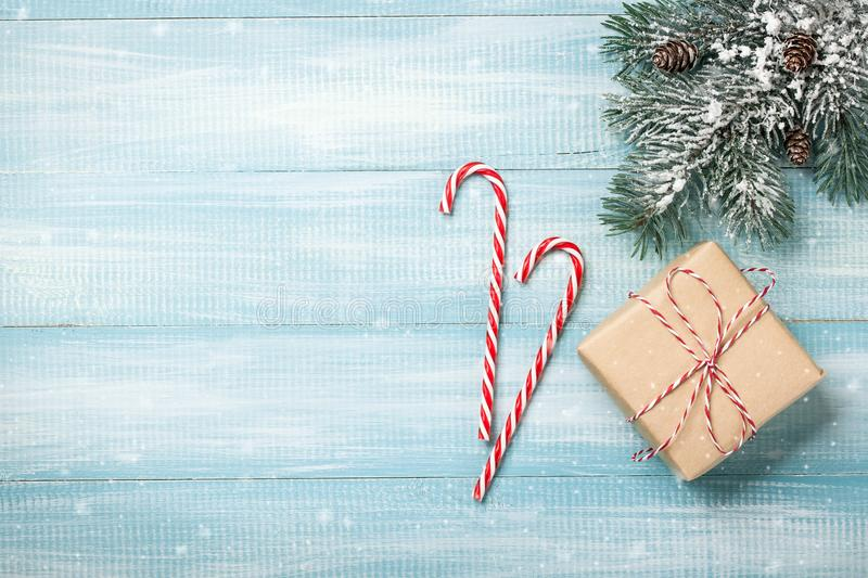 Christmas background with fir branches, gift box and candy canes stock images