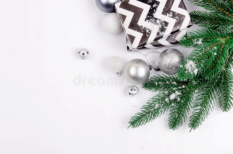 Christmas background with  fir branches, gifts, Christmas toys. Christmas decorative background with black and white christmas  gifts, ball and toys, fir stock photography