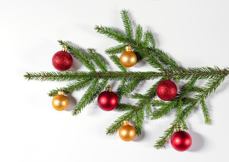 Christmas background with fir branches, gold and red balls. Flat lay, top view, copy space. stock photo