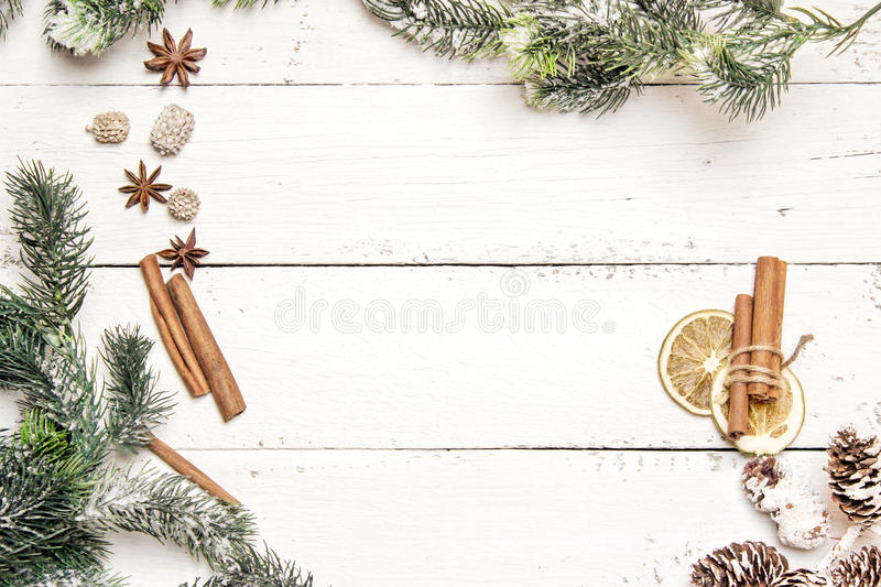 Christmas background with fir branches, pine cones, cinnamon sticks and anise stars. Top view. Copy space royalty free stock photography
