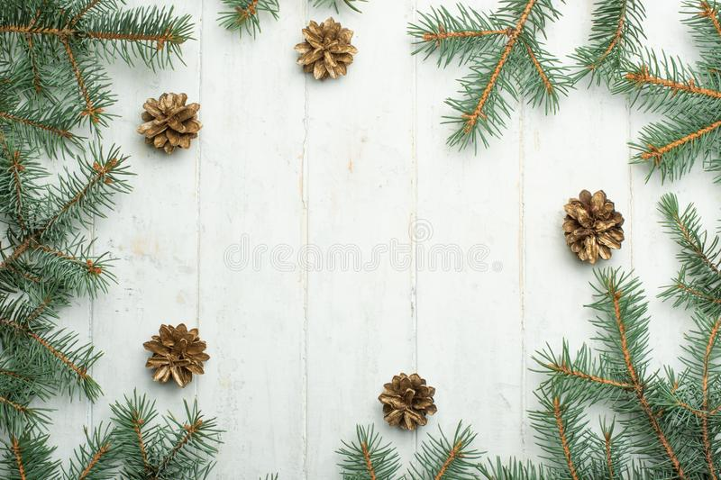 Christmas background with fir branches and pine cones. Floral New Year frame. Border with copy space. stock images