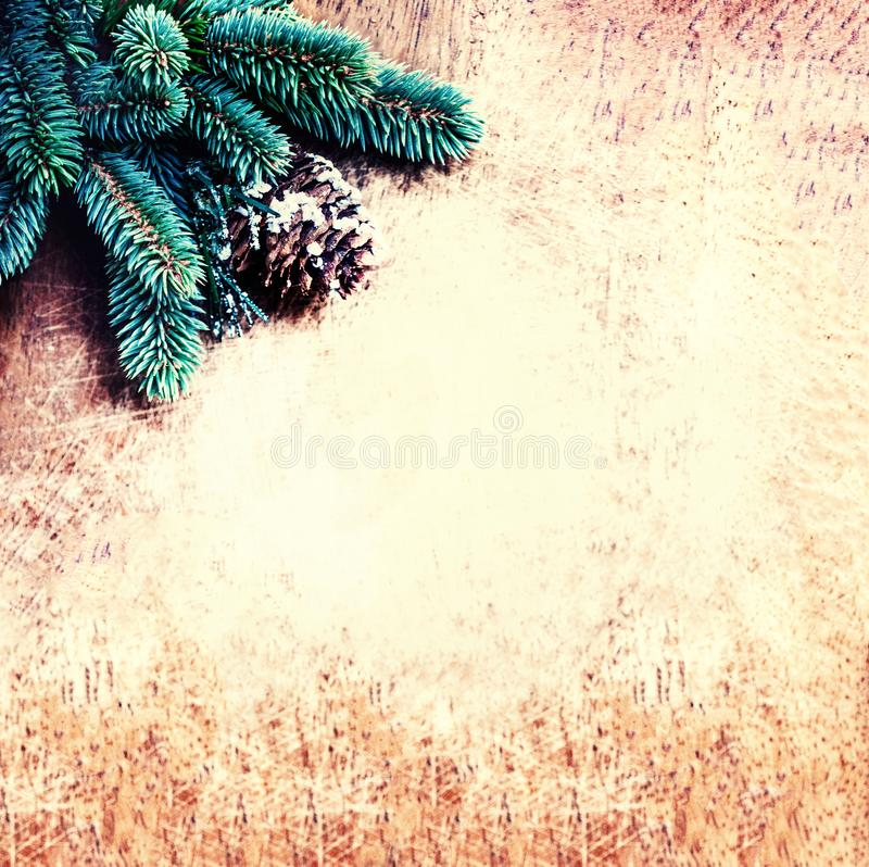 Christmas background with fir tree branch and decoration on vintage wood board. Copy space. Flat lay. Top view royalty free stock photos