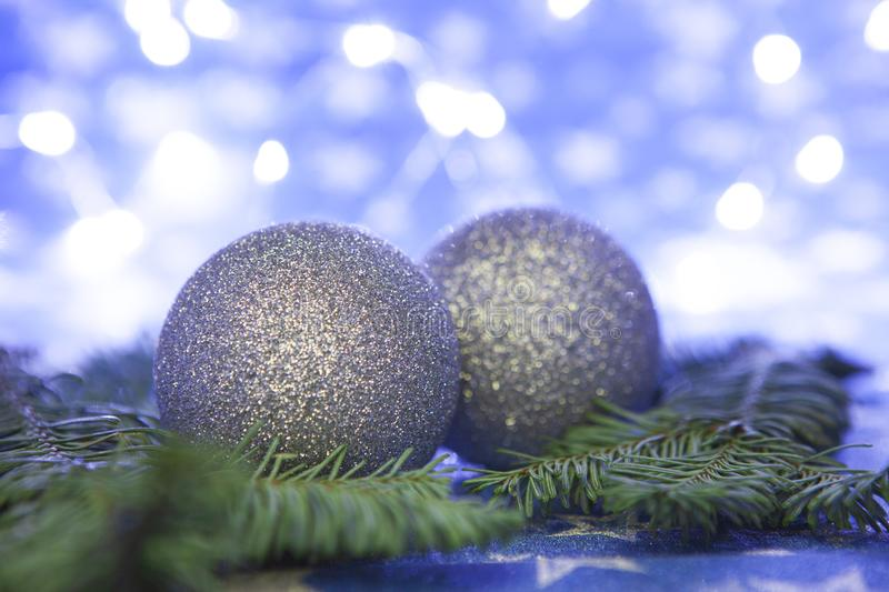 Christmas background. Fir tree branch and decorations on blue background royalty free stock photo