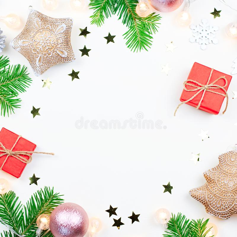 Christmas background with fir tree branches, Christmas lights, pink and beige decorations, silver ornaments stock images