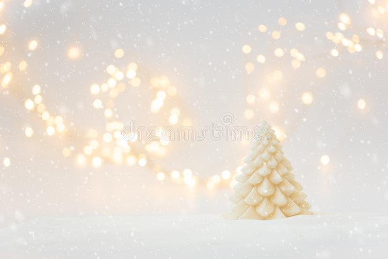 Christmas background with fir tree candle and defocused lights. Christmas or New Year celebration concept. Copy space.  stock photography