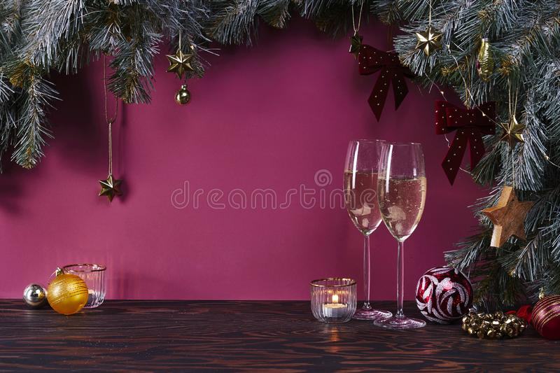 Christmas background with fir tree, champagne in glasses and decoration on dark wooden board, celebration at home royalty free stock photos