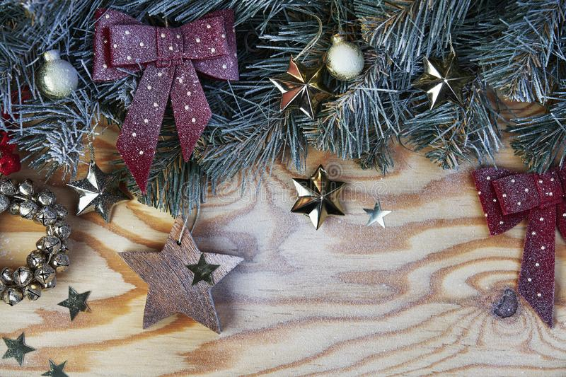 Christmas background with fir tree and decoration on light wooden board from above stock images