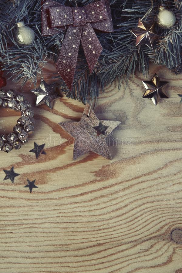 Christmas background with fir tree and decoration on light wooden board vintage image style, portrait royalty free stock photography