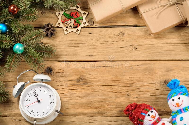 Christmas background with fir tree and decoration on wooden table stock image