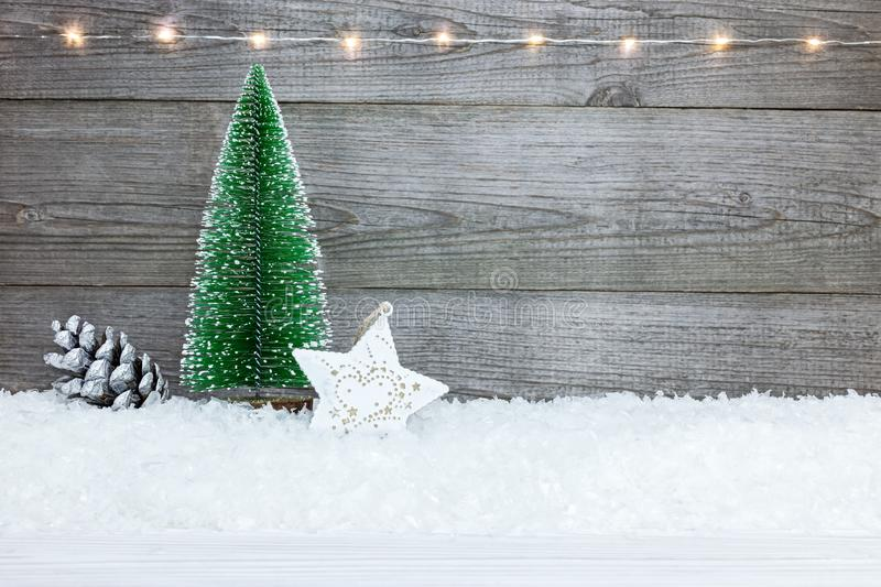 Christmas background with fir tree, star, pine cone and snow on royalty free stock photo
