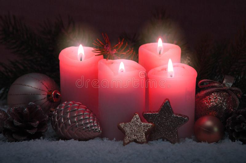 Four pink burning advent candles. Christmas card. royalty free stock photo