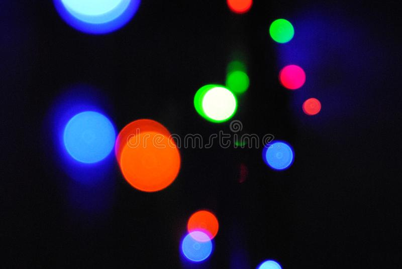 Christmas background, garland lights, glass ball, toys, glare night. New Year`s toys and ornaments background theme stock image