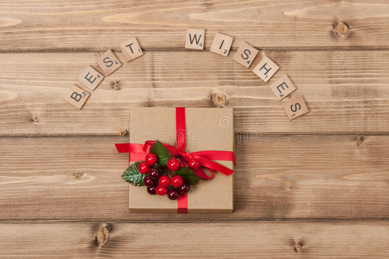 Christmas Background. Gift Box. Best Wishes Words. Wooden Table With Copy Space royalty free stock photo