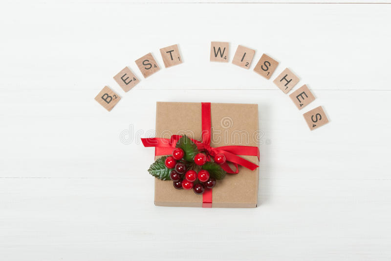 Christmas Background. Gift Box. Best Wishes Words. Wooden Table With Copy Space royalty free stock images