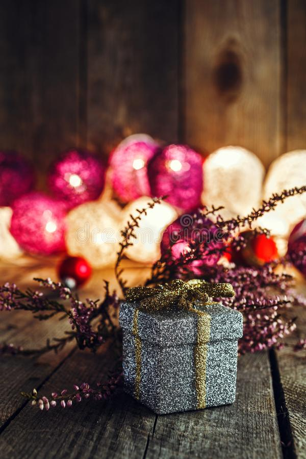 Christmas background with gift box and pink dried heather on woo stock images