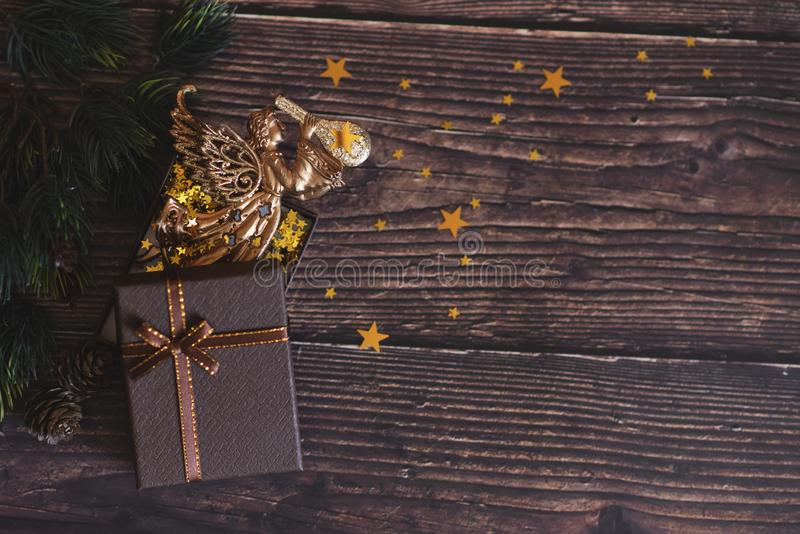 Christmas background with gift boxes, clews of rope, paper`s rools and decorations on red. Preparation for holidays. Top view wit royalty free stock image