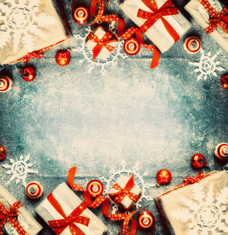 Christmas background with gift boxes, red festive holiday decorations and paper snowflakes. Top view, frame stock photos