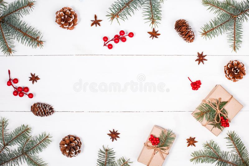 Christmas background with Christmas gift, fir branches, pine cones, snowflakes, red decorations. Xmas and Happy New Year compositi. On. Place for text. Flat lay stock photo