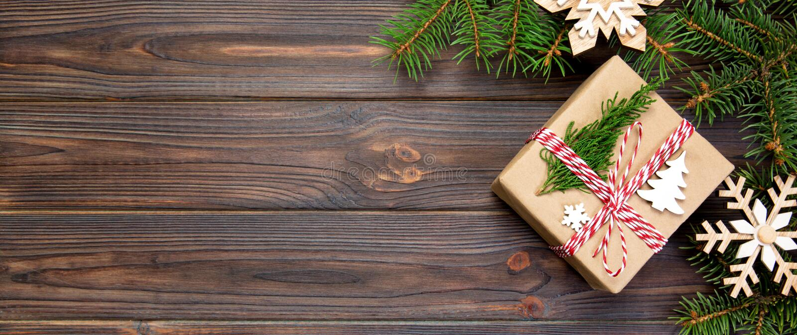 Christmas Background Christmas gift with fir branches and snowflake on wooden white background with banner copy space Flat lay, royalty free stock photos