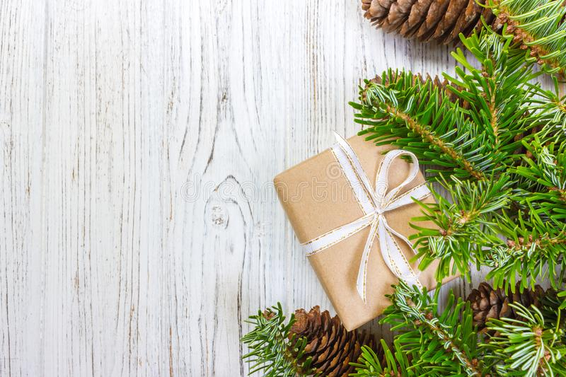 Christmas background with Christmas gift on wooden background with Fir branches. Xmas and Happy New Year composition. top view.  stock photos