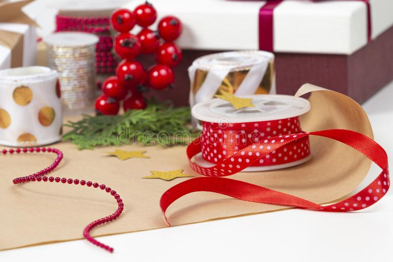 Christmas background with gifts present box, wrapping paper, ribbons, bows on white table.  royalty free stock photo