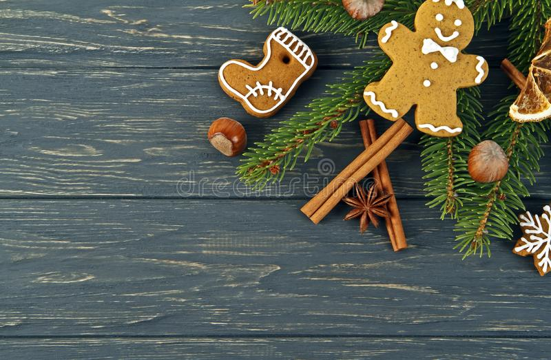 Christmas background. Ginger and Honey cookies with fir tree branches, cinnamon sticks and anise stars on wooden board stock photography