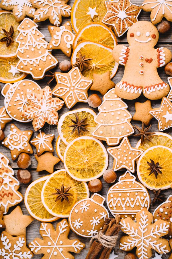 Christmas background with gingerbread cookies. Christmas and New Year celebration traditions. Texture with homemade gingerbread cookies, dried orange slices and stock photo