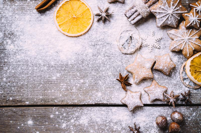 Christmas background with gingerbread cookies. Christmas and New Year celebration traditions. Texture with homemade gingerbread cookies, dried orange slices and royalty free stock image
