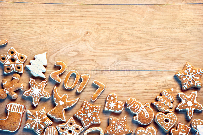 Christmas background with Gingerbread cookies on wooden table. royalty free stock image