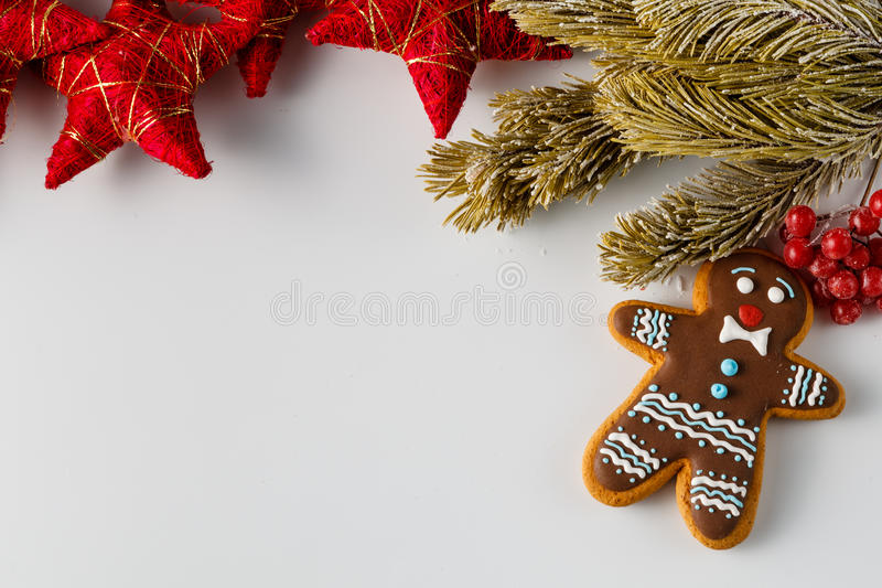 Christmas background with gingerbread men. Christmas background. Two gingerbread men on white with pine and stars royalty free stock photos