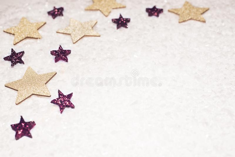 Christmas background, with golds and purple glitter stars and sn royalty free stock photos