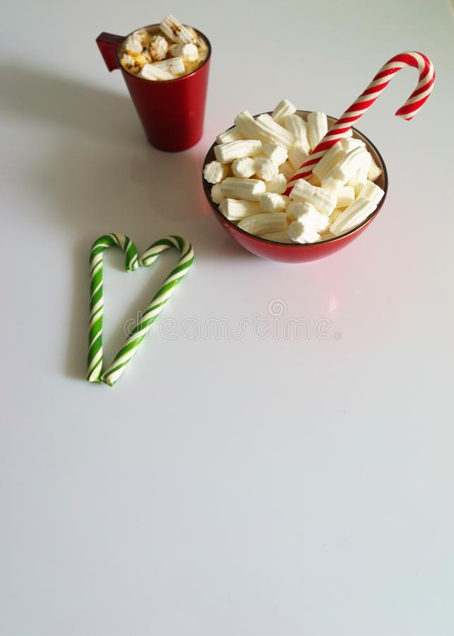 Christmas background, greeting card with a Cup of coffee or chocolate with marshmallows, lollipops and a red plate vector illustration