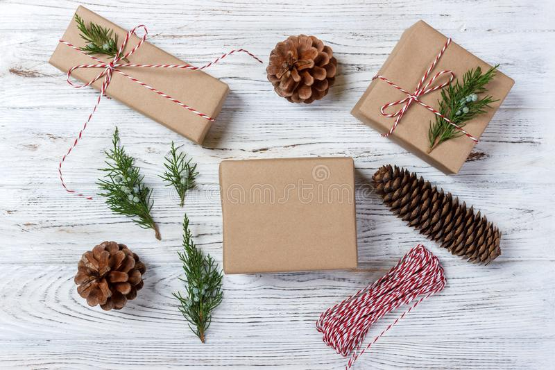 Christmas background with hand crafted gifts, presents on rustic wooden table. Christmas or New year DIY packing. Holiday decor co stock photography