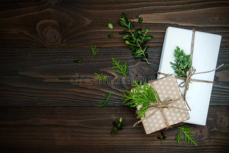 Christmas background with hand crafted gifts, presents on rustic wooden table. Overhead, flat lay, top view, copy space royalty free stock photos