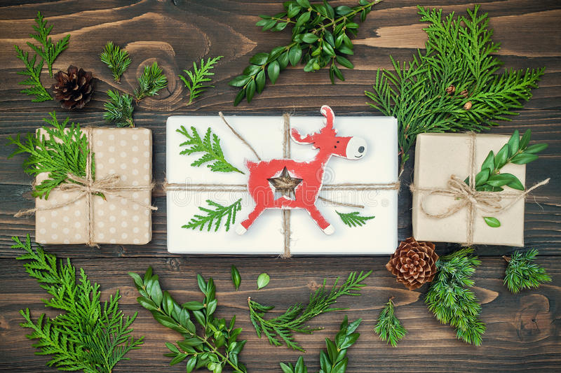 Christmas background with hand crafted gifts, presents on rustic wooden table. Overhead, flat lay, top view stock photography