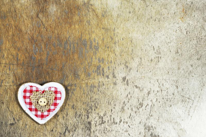 Christmas background. Christmas heart ornament on rusty background stock photography