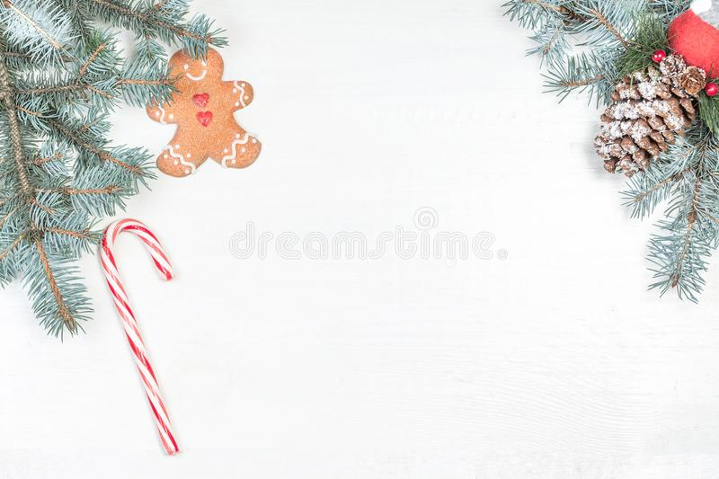 Christmas background with holiday decoration elements and fir tr. Ee branches on white wooden background. Christmas Flat lay and top view composition with border royalty free stock images