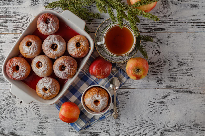 Christmas background of homemade oven baked apples, spices, nuts royalty free stock images